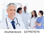 smiling doctor waiting for his... | Shutterstock . vector #107907074