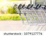 many metal shopping carts on a... | Shutterstock . vector #1079127776