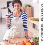 attractive woman preparing food ... | Shutterstock . vector #1079135708