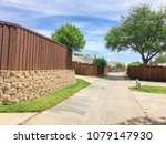 narrow back alley at  suburban... | Shutterstock . vector #1079147930