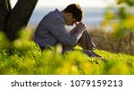 young man praying to god near a ... | Shutterstock . vector #1079159213