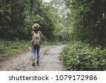 Traveller Women Walking On Roa...