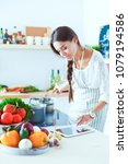 cooking woman in kitchen with... | Shutterstock . vector #1079194586