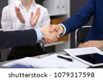 business people shaking hands ... | Shutterstock . vector #1079317598