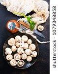 raw mushrooms  raw champignons  ... | Shutterstock . vector #1079348858