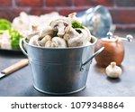 raw mushrooms  raw champignons  ... | Shutterstock . vector #1079348864