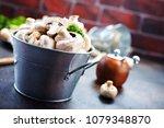 raw mushrooms  raw champignons  ... | Shutterstock . vector #1079348870