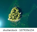 small island from above emerald ... | Shutterstock . vector #1079356154