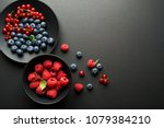 mix of fresh berries in a bowl... | Shutterstock . vector #1079384210