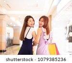 beautiful girls shopping in the ... | Shutterstock . vector #1079385236