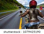 biker girl rides a mountain... | Shutterstock . vector #1079425190