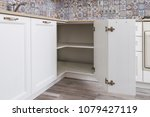 Stock photo solution for a kitchen corner in a cupboard the angular opening with corner hinges classical 1079427119