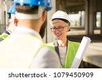 a beautiful woman engineer... | Shutterstock . vector #1079450909