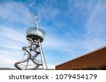 Small photo of WEIL AM RHEIN, GERMANY - JAN 27, 2017: Vitra Tour-Toboggan (Vitra Slide Tower) in Vitra Design Museum Campus by artist Carsten Höller. It consists of three diagonal columns with a clock at the top