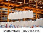 handling cargo in jumbo bags | Shutterstock . vector #1079465546