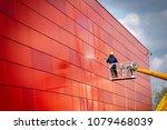 worker of professional facade... | Shutterstock . vector #1079468039