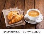cup of coffee and croissants on ... | Shutterstock . vector #1079486870