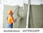 plasterer spreading plaster on... | Shutterstock . vector #1079501099