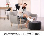 mature man with crutch and... | Shutterstock . vector #1079502800