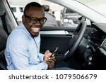 African Man With Glasses...