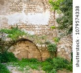 ancient immured arch covered... | Shutterstock . vector #1079574338