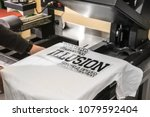 young man printing on t shirt... | Shutterstock . vector #1079592404