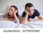 sad couple in the bed depressed ... | Shutterstock . vector #1079632583
