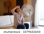 woman feeling hot and trying to ... | Shutterstock . vector #1079632643