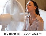 woman feeling hot and trying to ... | Shutterstock . vector #1079632649