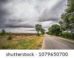 neglected village street cape... | Shutterstock . vector #1079650700