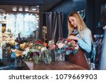 young attractive florist at the ... | Shutterstock . vector #1079669903