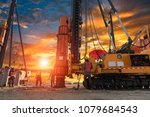 Small photo of The Silhouette Engineers of Business Engineers are piling on construction sites using unclear construction sites at sunset.