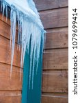 icicles on a wooden structure... | Shutterstock . vector #1079699414