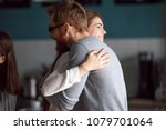 friendly hug concept  smiling... | Shutterstock . vector #1079701064