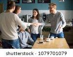 millennial guy handshaking... | Shutterstock . vector #1079701079