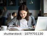 smiling millennial girl making... | Shutterstock . vector #1079701130