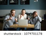 Small photo of Multiracial men drinking beer celebrating victory watching online football game match on laptop in pub restaurant, diverse friends supporting team excited with goal result, sport betting win concept