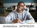 happy african casual man in...   Shutterstock . vector #1079701274