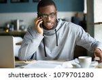 african businessman talking on... | Shutterstock . vector #1079701280