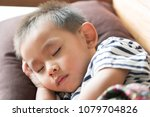 take a nap  asian boy sleeping... | Shutterstock . vector #1079704826