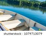 fishing boat in calm lake water ... | Shutterstock . vector #1079713079
