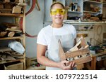 happy female worker with wooden ... | Shutterstock . vector #1079722514