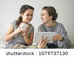 two positive sisters shopping... | Shutterstock . vector #1079737130