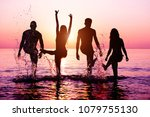 happy friends splashing water... | Shutterstock . vector #1079755130