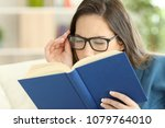 woman suffering eyestrain... | Shutterstock . vector #1079764010