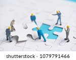 miniature people team trying to ... | Shutterstock . vector #1079791466
