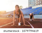 women sprinters at starting... | Shutterstock . vector #1079794619