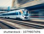 high speed passenger train in... | Shutterstock . vector #1079807696