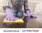 woman using spray cleaner on... | Shutterstock . vector #1079807828