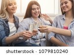 three young women drinking... | Shutterstock . vector #1079810240